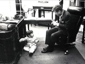 John-John hiding under his father's desk in the Oval Office (Source: USA Today)