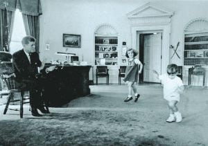 Caroline and John-John playing in the Oval Office (Source: The Tuscon Citizen)