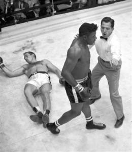 Ingemar Johansson lies on the canvas after challenger Floyd Patterson flattened him in the fifth round at the Polo Grounds in New York on June 20, 1960. With the knockout, Patterson regained the heavyweight championship. (Source: Boxnews.com) Copyright: Associated Press